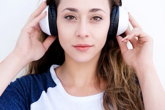 Close up young woman with headphones on head