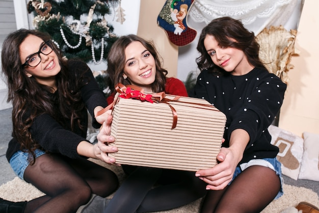 Close-up of young women holding a gift