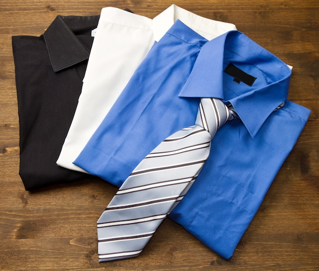 Close upfield with stacked shirts with tie.