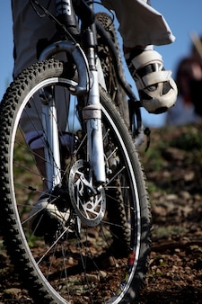 Close view of the action of a boy riding a bike on the dirt.