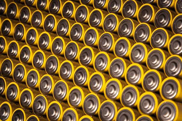 Close view of batteries alkaline 1.5 volts in size aa several batteries in rows