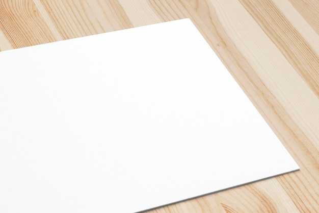Close view of blank paper card on wooden desk. 3d render.