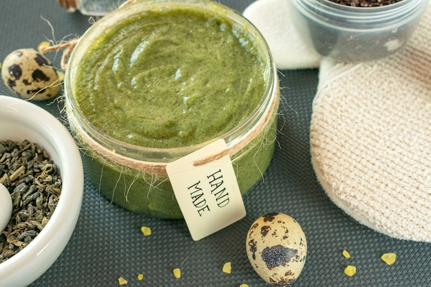 Close view of body care product scrub or mask with handmade tag. spa still life