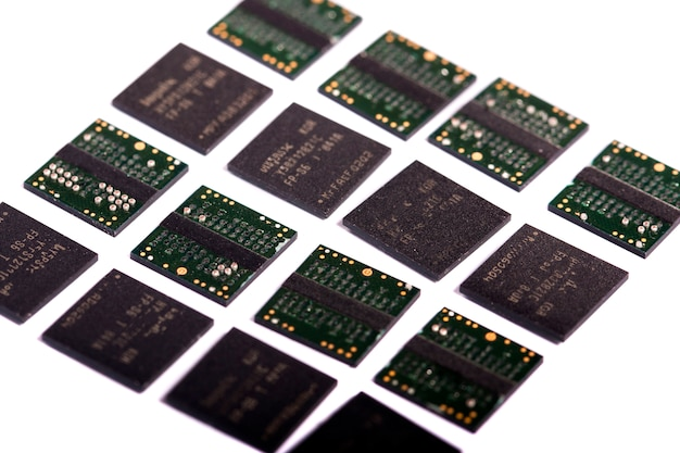 Close view of a bunch of computer memory chips isolated on a white background.