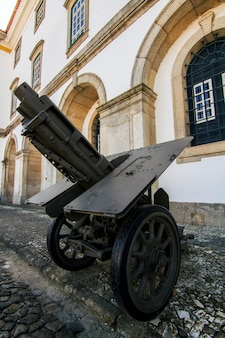 Close view of a cannon field artillery on the street.
