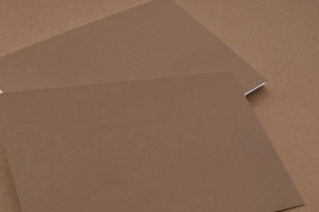 Close view of carton paper business cards on cardboard background