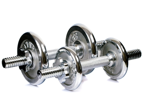 Close view of a chrome dumbbell equipment isolated on a white background.
