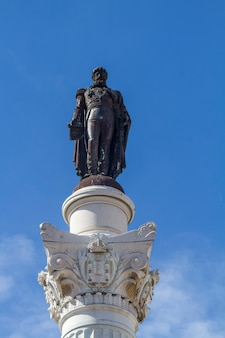 Close view of the column of pedro iv located in the rossio square, lisbon, portugal.