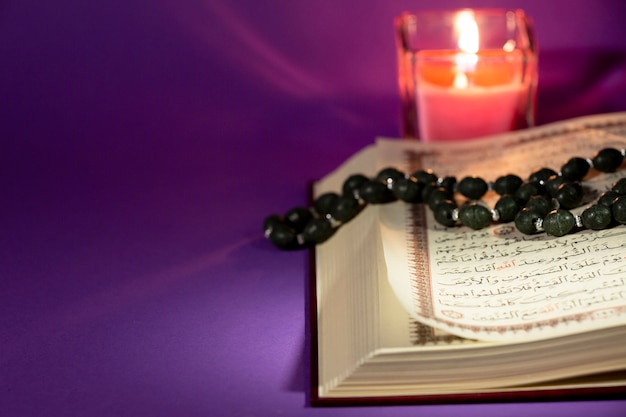 Close view quran with candle