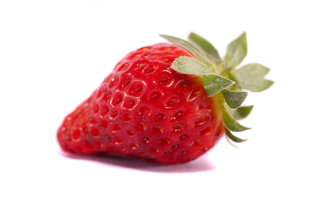 Close view of strawberries fruits isolated on a white background.