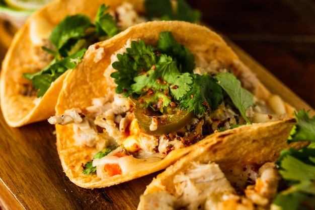 A close view of a taco with chicken and jalapeno and cilantro