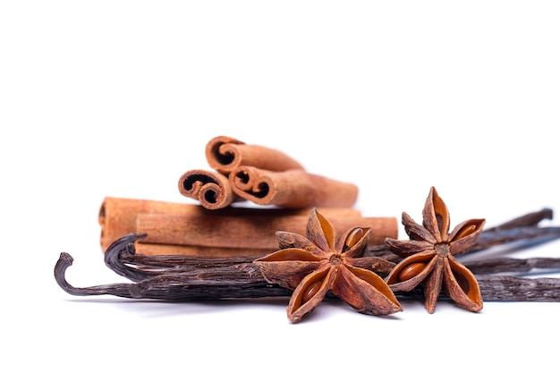 Close view of vanilla pods, anise, stars and cinnamon sticks.