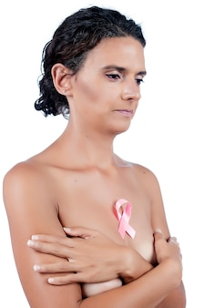 Close view of woman with pink breast awareness cancer ribbon