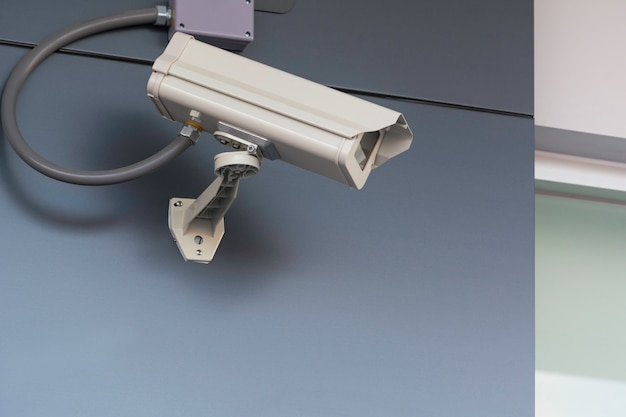 Closed circuit television camera. closed circuit television recording from front of house.
