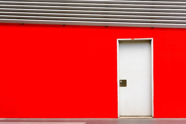 Closed door on red wall at capital of malaysia kuala lumpur with copyspace