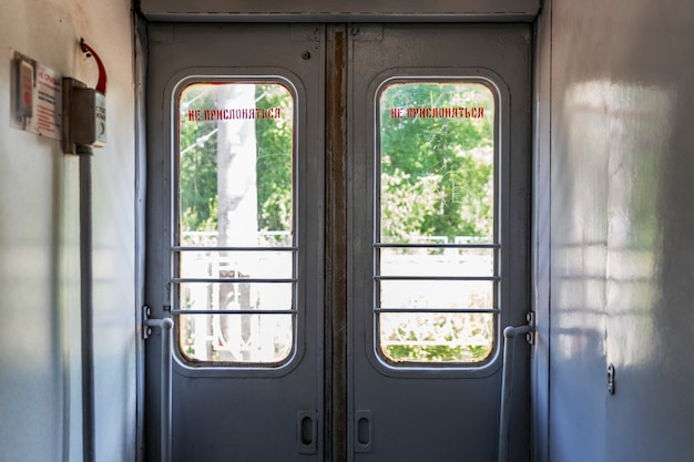 Closed doors in the vestibule of the train.