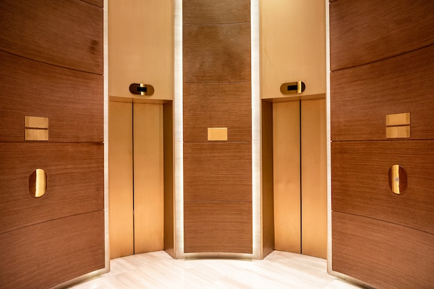 Closed elevator doors. contemporary interior wooden curve