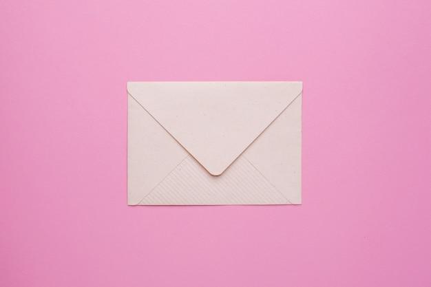 Closed envelope on pink