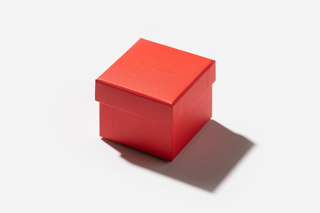Closed little present box made of red paper, isolated on white background