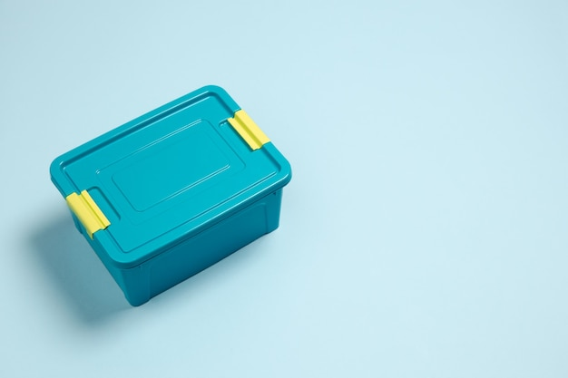 Closed lunch box. monochrome stylish and trendy composition in blue color on background. top view, flat lay. pure beauty of usual things around. copyspace for ad. food, work, nutrition.