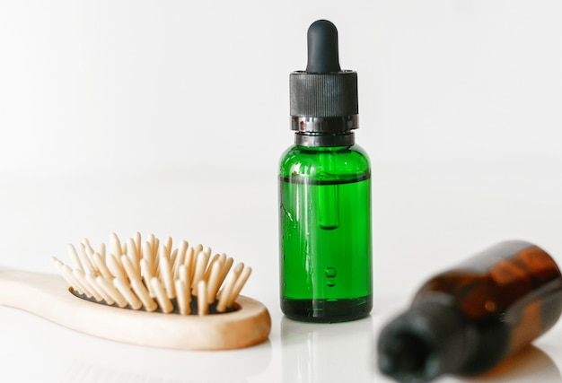 Closed medicine bottle with dropper isolated on soft gray background.little dropper bottle.