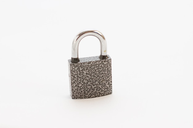 A closed metal padlock on a white background