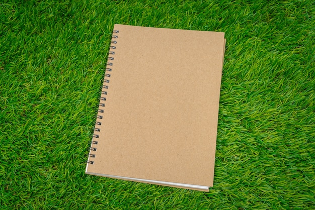 Closed notebook on grass