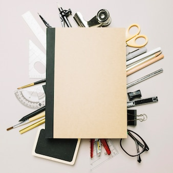 Closed notebook on office supplies