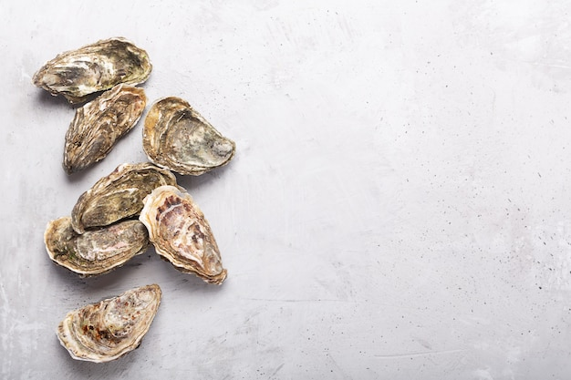 Closed oysters on wooden background. healthy sea food
