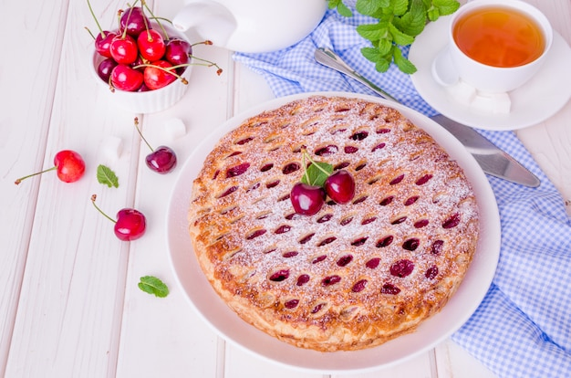 Closed puff pastry cake with cherry filling
