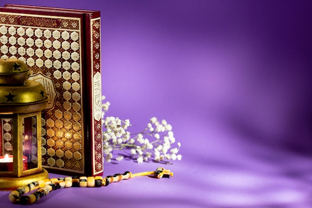 Closed quran with purple background studio shot