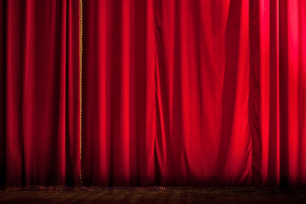 Closed red theater curtain backdrop