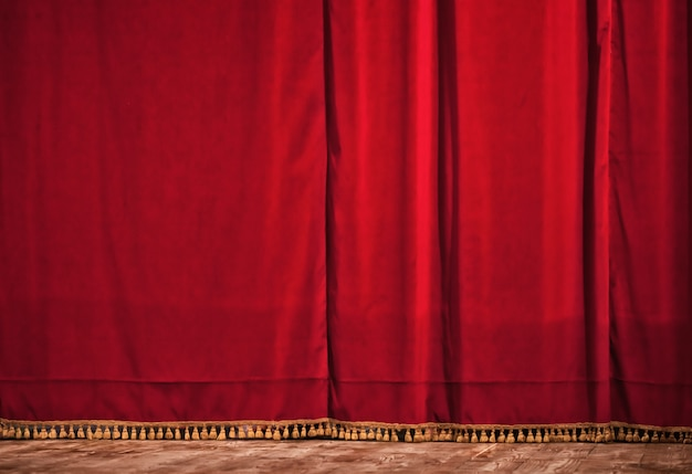 Closed red theater curtain