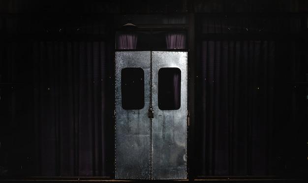 A closed retro iron door on the classic exterior