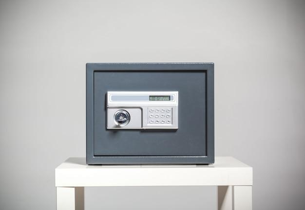 Closed safe on grey background