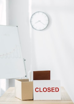 Closed sign and box arrangement