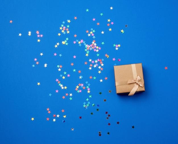 Closed square gift box with confetti