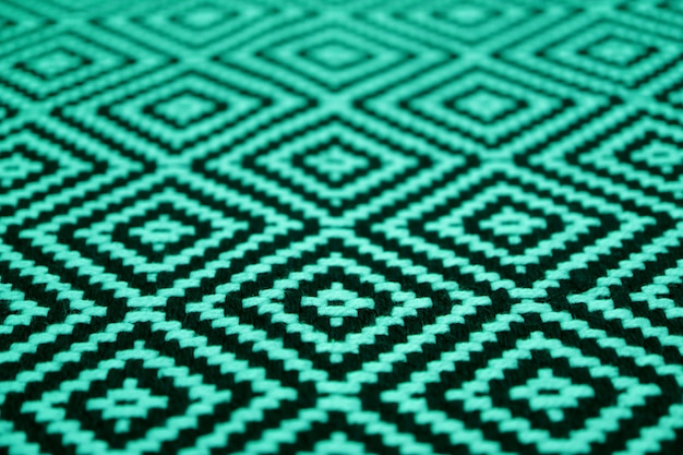 Closed up beautiful mint green and black colored ethnic pattern fabric
