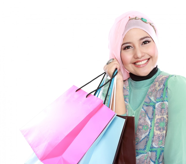 Closed up of happy young muslim woman with shopping bag