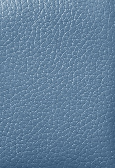 Closed up light blue colored genuine leather, for background, texture, pattern