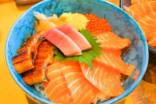 Closed up mix fresh raw secfood on topped rice bowl (donburi) - japanese food