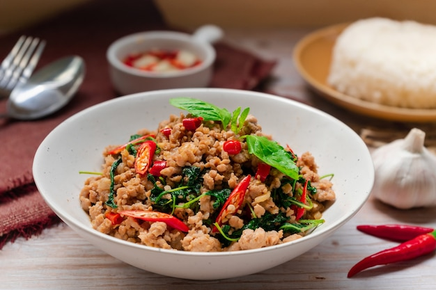 Closed up pad krapo  thai food that stir fried basil with pork hot and spicy tasty serving with rice