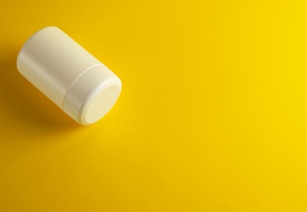 Closed white plastic jar for medicines