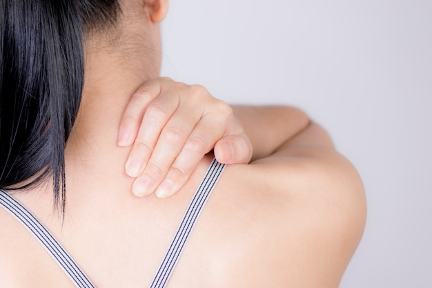 Closenup woman neck and shoulder pain and injury
