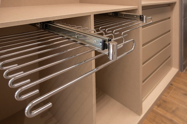 Closet with removable metal accessory for clothes hanging