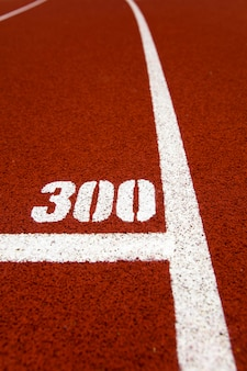Closeup of the 300 meters mark red stadium running track