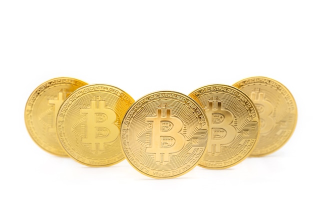 Closeup of 5 gold bitcoin coins isolated on white background