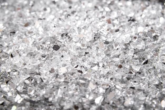 Closeup abstract broken cracked glass. broken glass background. shards. looks like coal.
