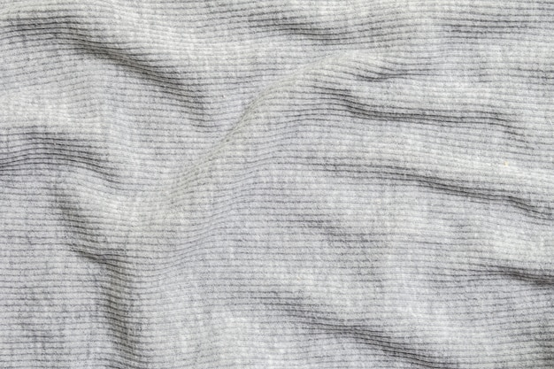 Closeup abstract pattern at wrinkled gray women's clothing textured background