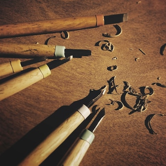 Closeup aerial view of wood sculpter carpenter chisel tools